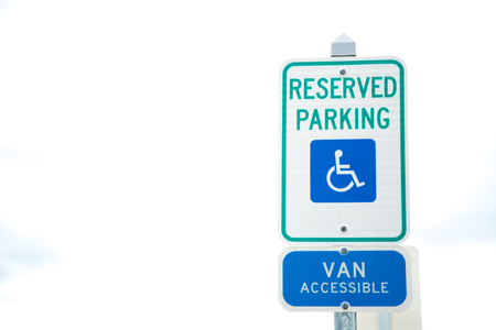 Disabled parking space and wheelchair way sign and van accessible sign in boston. Stock Photo