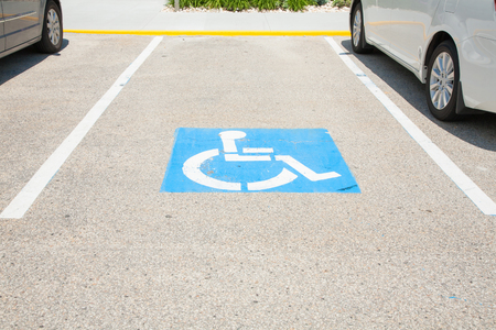 Logos for disabled on parking. handicap parking place sign in boston city. Stock Photo