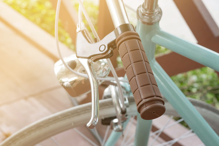 Handlebar of a bicycle on natural bokeh background. Travel and exercise concept Stock Photo