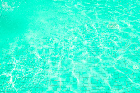 Green waves water in swimming pool and sun bright. concept color summer. Stock fotó