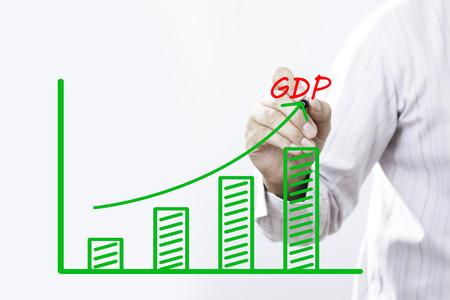 Businessman hand write GDP concept. Stock Photo