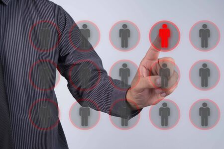 outsider: Human resources officer choose employee standing out of the crowd. Leadership concept Stock Photo