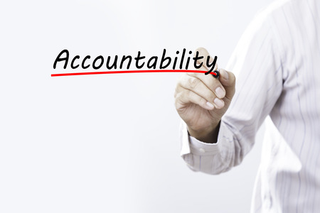culpable: Businessman hand writing Accountability with red marker on transparent wipe board, business concept Stock Photo
