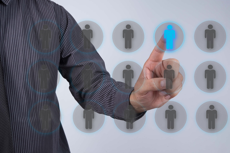 enterprising: Human resources officer choose employee standing out of the crowd. Leadership concept Stock Photo