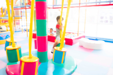 Abstract blur happy kids playing on slide, Indoor children playground. Stock Photo