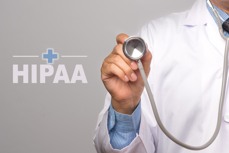 Doctor holding a stethoscope and word Stockfoto