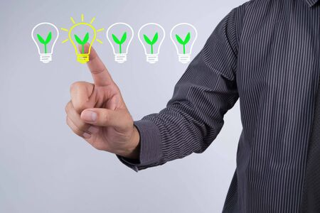Great Idea and Creativity Concept, Businessman touch screen icon light bulbs. Stock Photo