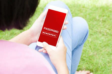 Top view of woman using her mobile phone  with password on her mobile phone. Stock Photo