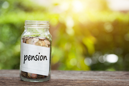 pension Word With Coin In Glass Jar. Stock Photo
