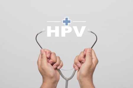 Hands holding a stethoscope and word Stockfoto
