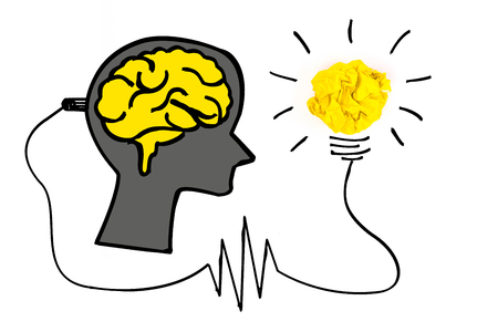 Creative concept. Brain plugged in to produce ideas and a yellow light bulb made of yellow crumpled, paper ball.