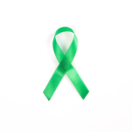 green kelly bow ribbon on white background. kidney cancer concept Stock Photo