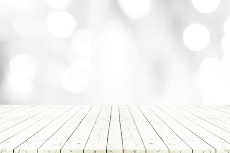is green: Perspective white wooden table on top over blur natural background, can be used mock up for montage products display or design layout. Stock Photo