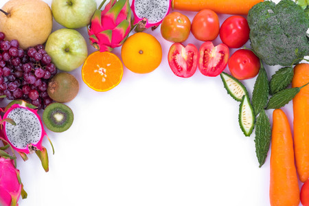 Healthy concept. Different fruits and vegetables on white background.