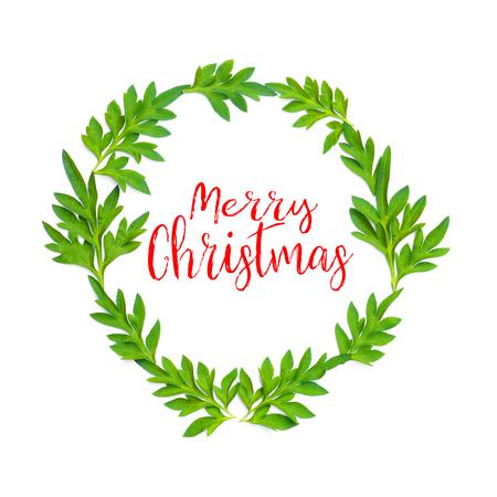 Parole Di Buon Natale.Parole Di Buon Natale E Foglie Verdi Fresche In Cerchio Su Priorita Bassa Bianca