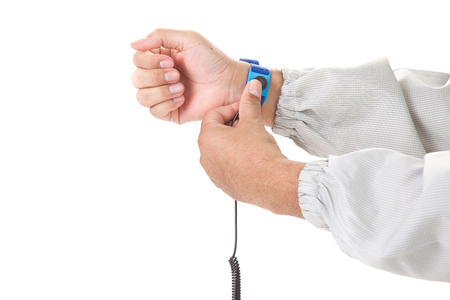 Bracelet on the hand of a man wearing ESD cloth isolated on white background static resistance (ESD) bracelet or ground equipment, anti-static, used to safely ground is working. electronic devices