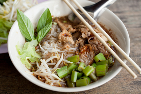 stewed pork nooddle soup, Noodle soup thai style put blood in the soup hot for mellow soup (Pork or Beef) on wooden table Stock Photo