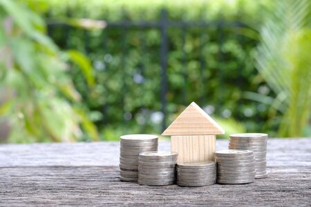 coin and house, concept for home loans Stock Photo