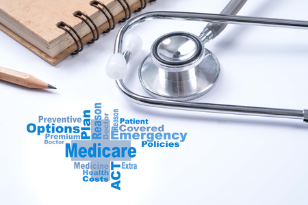 Stethoscope, notebook and pencil with Medicare word, Medical concept.