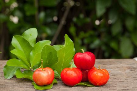 Acerola cherry of thailand on wood. Select focus, Barbados cherry, Malpighia emarginata, high vitamin