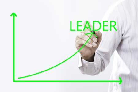 Leader Text With Businessman Hand Point On Virtual Graph Green line. Stock Photo