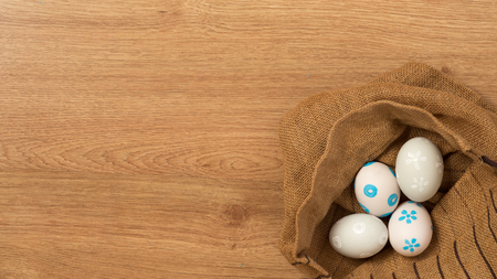 Handmade easter eggs a isolated on wooden background.