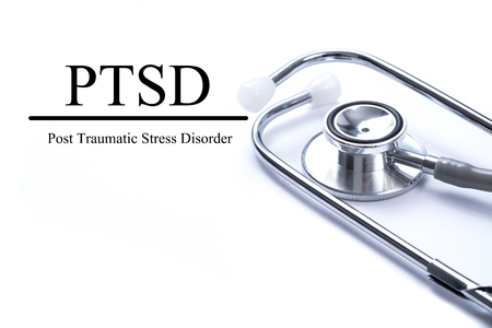 Page with PTSD - post traumatic stress disorder. War veteran mental health issue on the table with stethoscope, medical concept.