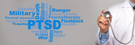 Health Care Concept. Doctor holding a stethoscope and PTSD - post traumatic stress disorder words on gray background. War veteran mental health issue.