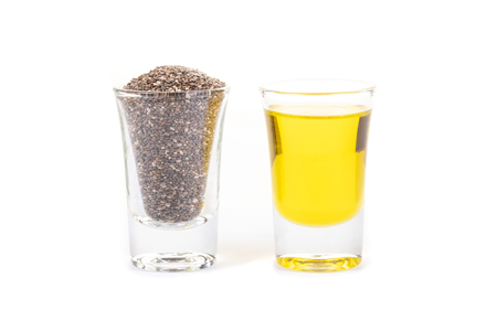 Chia seeds and chia oil on white background.Organic chia seed oil.Healthy food,superfood. Healthcare concept.