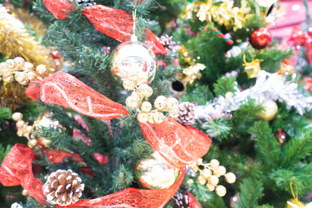 Blur of Christmas tree in shopping mall for background.