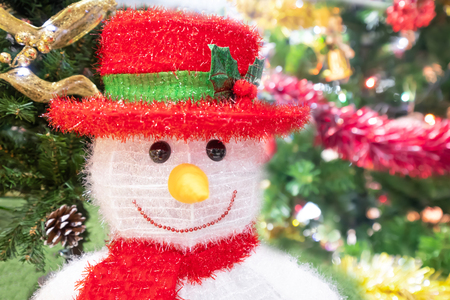Blur of Christmas tree and Snowman in shopping mall for background.