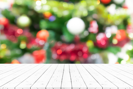 Perspective empty wooden table and christmas tree blur decoration background, for product display montage or design layout. Stock Photo
