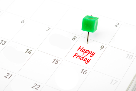 Happy friday written on a calendar with a green push pin to remind you and important appointment. Stock Photo