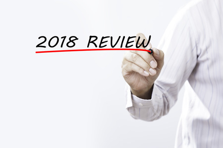 Businessman hand writing 2018 review with red marker on transparent wipe board, business concept Stock Photo