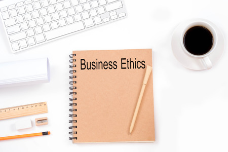 Business Ethics word with modern workplace on white background.