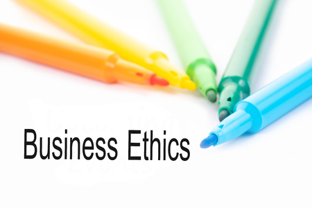 Colorful felt-tip pen and Business Ethics word on white background.