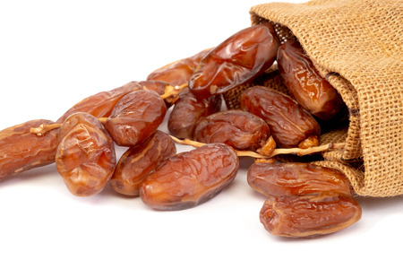 Close up of cluster dates plam. Fresh dates plam over white background.