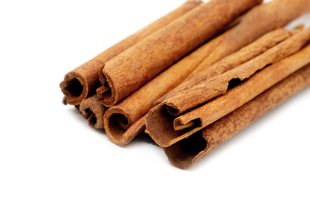 Top view cinnamon sticks isolated on white background.