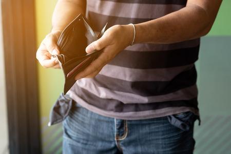 Empty wallet in the hands of man. Broke ,bankrupt concept. Stock Photo