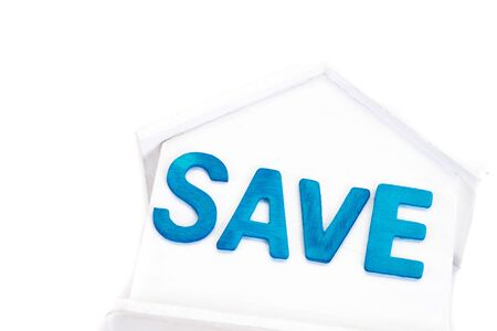 Save word on house is white Piggy bank on white background.Time to invest, real estate and property concept. Finance saving and investment concept. 写真素材