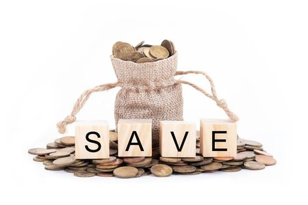 Save word on blocks of wooden. Money bags and coins on white background.Time to invest, time value for money, money saving, finance saving and investment concept.