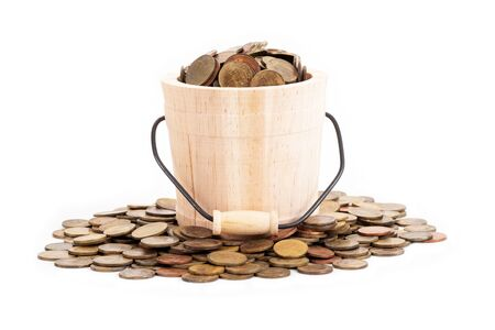 Wooden bucket and coins on white background.Time to invest, time value for money, family planning, money saving, finance saving and investment concept. 写真素材