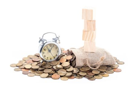 Vintage alarm clock bell, empty wooden blocks on Money bags and coins on white background.Time to invest, time value for money, money saving, finance saving and investment concept.