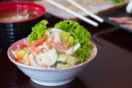 Fresh vegetable salad with crab stick in japanese restaurant, japanese food.