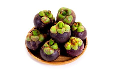 Mangosteen in wooden tray on white background. Queen of friuts.