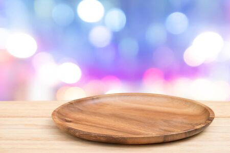 Empty wooden tray on perspective wooden table on top over blur background. Can be used mock up for montage products display or design layout. Imagens - 133376173