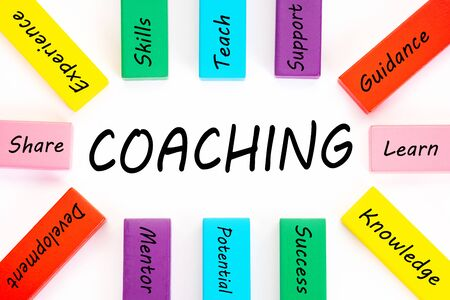 coaching word with wooden block on white background. Training Planning Learning Coaching Business Guide Instructor Leader concept. Imagens