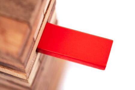 Stacked wooden block and red block on white background. Symbol of leadership, teamwork and different. Business and design concept. 写真素材