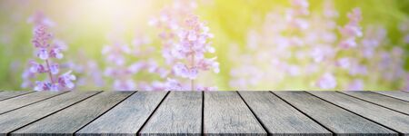 Emtry wooden table on top over blur natural background, can be used mock up for montage products display or design layout. Imagens
