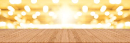 wooden pine table on top over blur background, can be used mock up for montage products display or design layout.